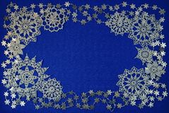 Background with snowflakes. Blue background with different knitted snowflakes stock photo
