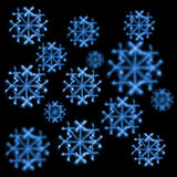 Background of snowflakes made  with sparklers on black Stock Images