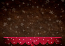 Background with snowflakes and red table. Stock Photo