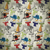 Background with snowmen in different outfits in vintage Royalty Free Stock Photography