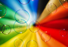 Soap bubbles and multi-coloured background Stock Photography