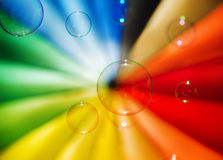 Soap bubbles and multi-coloured background Stock Image