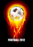 Background with a soccer ball and fire. Soccer ball in flames on a dark background Royalty Free Stock Image