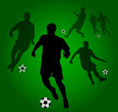 Background with Soccer players silhouettes Stock Image