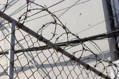 Background about the social problems of illegal immigration. Fence with barbed wire a background typically surrounds prison, country borders and private property royalty free stock photo