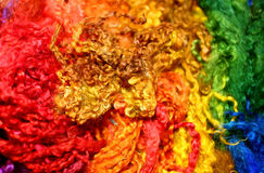 background with soft wool strands and curls of a thousand colors Royalty Free Stock Photo