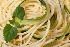 Background spaghetti pasta with zucchini and mint close-up Stock Photography
