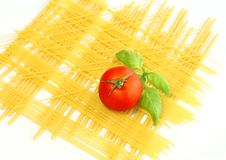 background from spaghetti, tomato and basil Royalty Free Stock Images