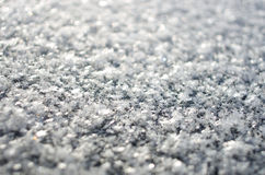 Background with spangles. Macro shot of snowflakes with bokeh Stock Images