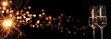 Background with sparkling miracle candle and champagne Stock Photo