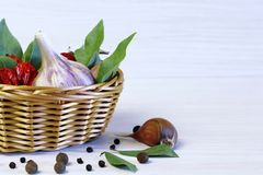 Background and spices. The bay leaf in a wicker basket, garlic a stock photo