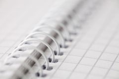 Background of spiral notebook. An abstract macro shot of spiral notebook Royalty Free Stock Photo