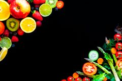Background with spring and summer fruits and vegetables on black table. Background with spring and summer fruits and vegetables stock photos