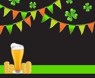 Background St. Patrick's Day. Glass of beer on a dark background with flags, clover and coins Stock Photography