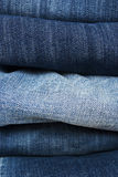 Background of a stack blue jeans Royalty Free Stock Photos