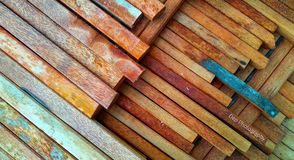 the background of a stack of coconut wood neatly arranged ready to be used as building construction material stock photography
