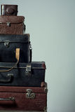 Background stack of old shabby suitcases and camera Royalty Free Stock Photography
