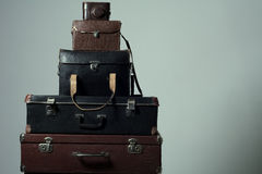 Background stack of old shabby suitcases and camera Royalty Free Stock Images