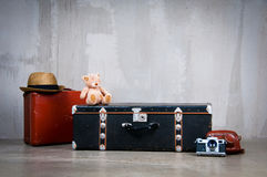 Background stack of old shabby suitcases and the camera. Royalty Free Stock Images