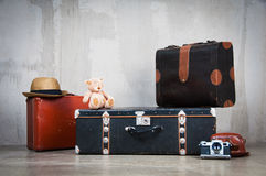 Background stack of old shabby suitcases and the camera. Stock Photo