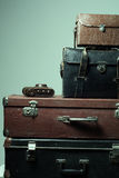 Background stack of old shabby suitcases and camera Royalty Free Stock Photo