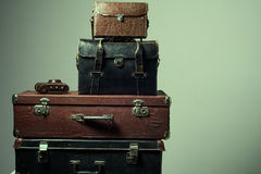 Background stack of old shabby suitcases and camera Stock Images