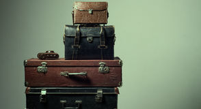 Background stack of old shabby suitcases and camera Stock Photos