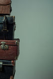 Background stack of old shabby suitcases form a tower Stock Images
