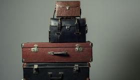 Background stack of old shabby suitcases form a tower Royalty Free Stock Images