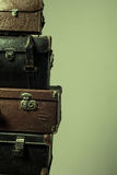 Background stack of old shabby suitcases form a tower Royalty Free Stock Photography