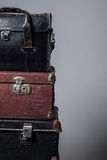 Background stack of old suitcases Stock Photo