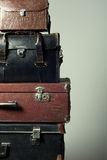 Background stack of old suitcases form a tower Stock Image