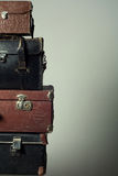 Background stack of old suitcases form a tower Stock Images