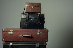 Background stack of old suitcases form a tower Stock Photography