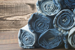Background of a stack rolled jeans stock images