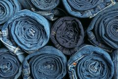 Background of a stack rolled jeans royalty free stock photo