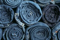 Background of a stack rolled jeans royalty free stock photography