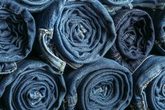 Background of a stack rolled jeans stock photo