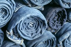 Background of a stack rolled jeans royalty free stock image