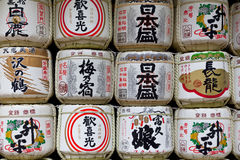 Background of a stack of sake barrels donated in a japanese shrine Royalty Free Stock Photo