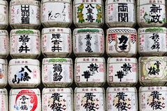 Background of a stack of sake barrels donated in a japanese shrine Stock Image