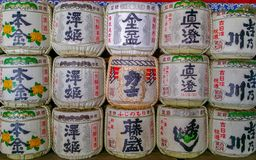 Background of a stack of sake barrels. Tokyo, JAPAN - Aug. 12, 2017: Background of a stack of sake barrels donated in a japanese shrine Royalty Free Stock Images