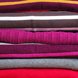 Background with stack of warm knitting clothing Stock Photography