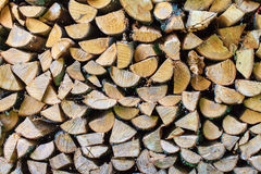 Background of Stacked Chopped Firewood Logs Stock Photography