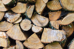 Background of Stacked Chopped Firewood Logs Royalty Free Stock Photo
