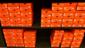 Background of stacked Nike shoes boxes Stock Photo