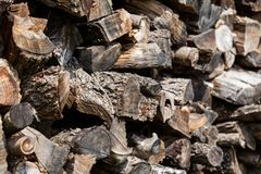 Background from stacked old brown stab wooden logs royalty free stock photography