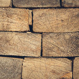 Background of Stacked Wood Cut in   Squared Timber Royalty Free Stock Photo