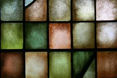 Background stained glass. Large glass window with different color squares of glass royalty free stock photography