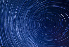 Background of star trails in sky Stock Images